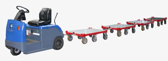 Routenzug mit blauem Schlepper und vier Anhängern
